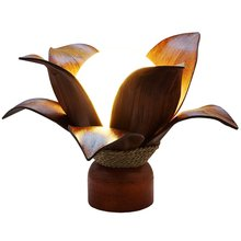 Lamp blossom with Coconut palm leaves